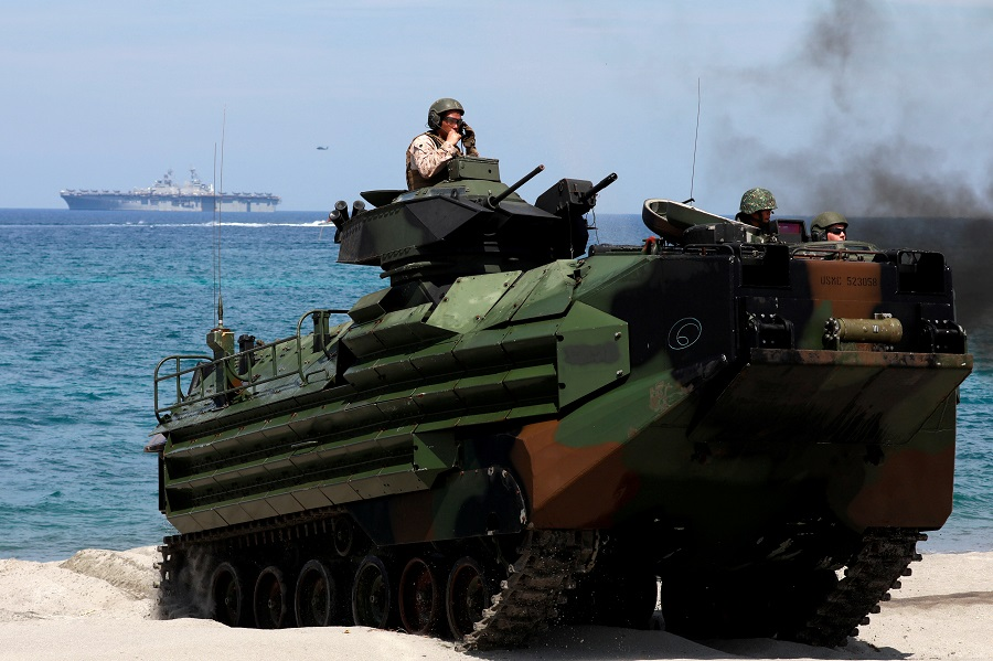 With the USS-Wasp in the background, US Marines ride an amphibious assault vehicle during the amphibious landing exercises of the US-Philippines war games promoting bilateral ties at a military camp in Zambales province, Philippines, on 11 April 2019. (Eloisa Lopez/File Photo/Reuters)