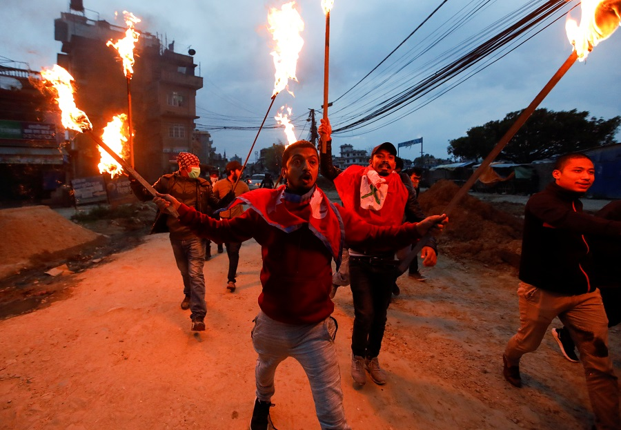 Students with torches protest against the alleged encroachment of Nepal border by India in far west of Nepal, in Kathmandu, Nepal, on 11 May 2020. (Navesh Chitrakar/Reuters)