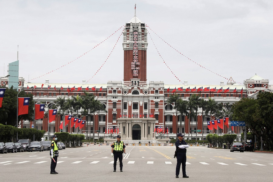 Police officers stand guard in front of the Presidential Office Building during the inauguration ceremony of Taiwan President Tsai Ing-wen in Taipei, Taiwan, on 20 May 2020. (Ann Wang/Reuters)