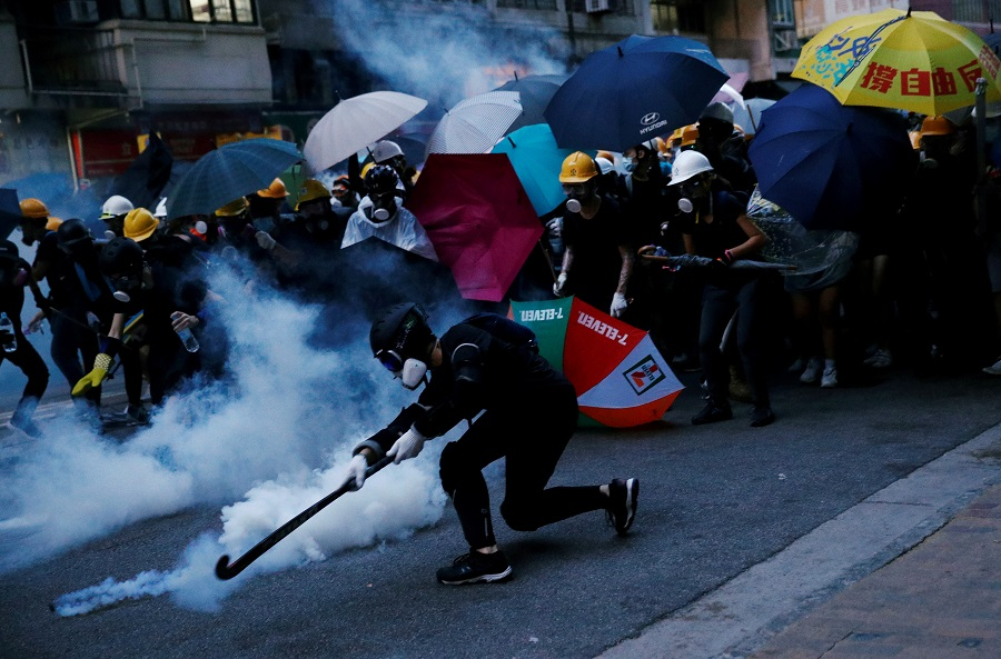 Demonstrators clash with police during a protest against police violence during previous marches, near China's Liaison Office in Hong Kong, on 28 July 2019. (Edgar Su/File Photo/Reuters)