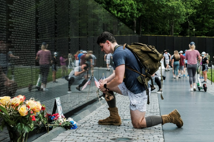 Members of the U.S. military, veterans and members of the public visit the Vietnam Veterans Memorial in the midst of the coronavirus disease (COVID-19) pandemic while commemorating the U.S. Memorial Day holiday in Washington, U.S., May 25, 2020.