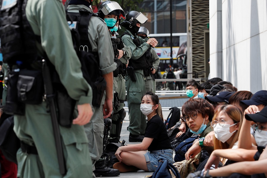 Anti-government demonstrators are detained by riot police during a protest at Causeway Bay in Hong Kong, China, on 27 May 2020. (Tyrone Siu/Reuters)