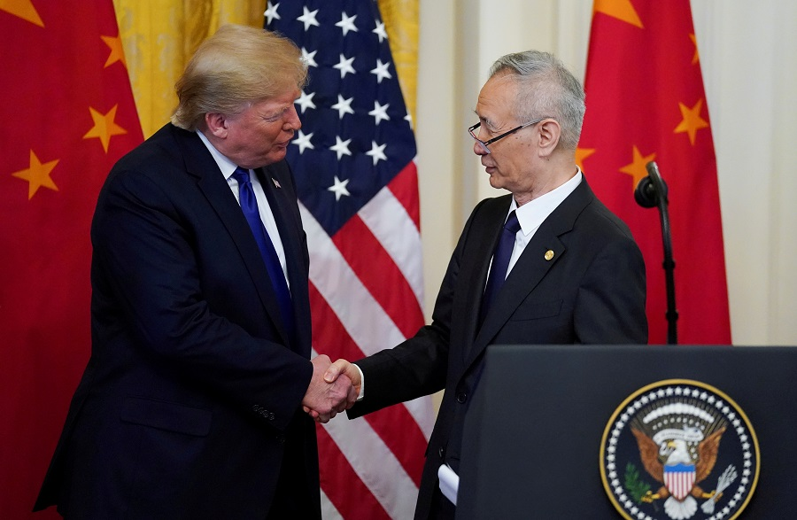 "US President Donald Trump shakes hands with Chinese Vice Premier Liu He during a signing ceremony for ""phase one"" of the US-China trade agreement in the East Room of the White House in Washington, US, 15 January 2020. (Kevin Lamarque/File Photo/Reuters)"