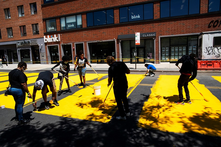 People paint a 'Black Lives Matter' mural on the street as a protest against racial inequality in the aftermath of the death of George Floyd in Minneapolis police custody, in Brooklyn, New York City, US, on 14 June 2020. (Eduardo Munoz/Reuters)