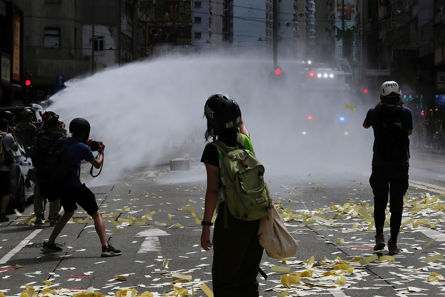 Riot police use water cannon to disperse anti-national security law protesters. REUTERS/Tyrone Siu