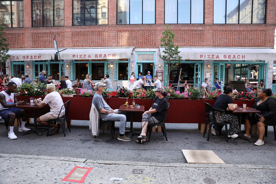 People dine at Hair of the Dog on Orchard street in lower Manhattan, New York, US, on 4 July 2020. (Caitlin Ochs/Reuters)