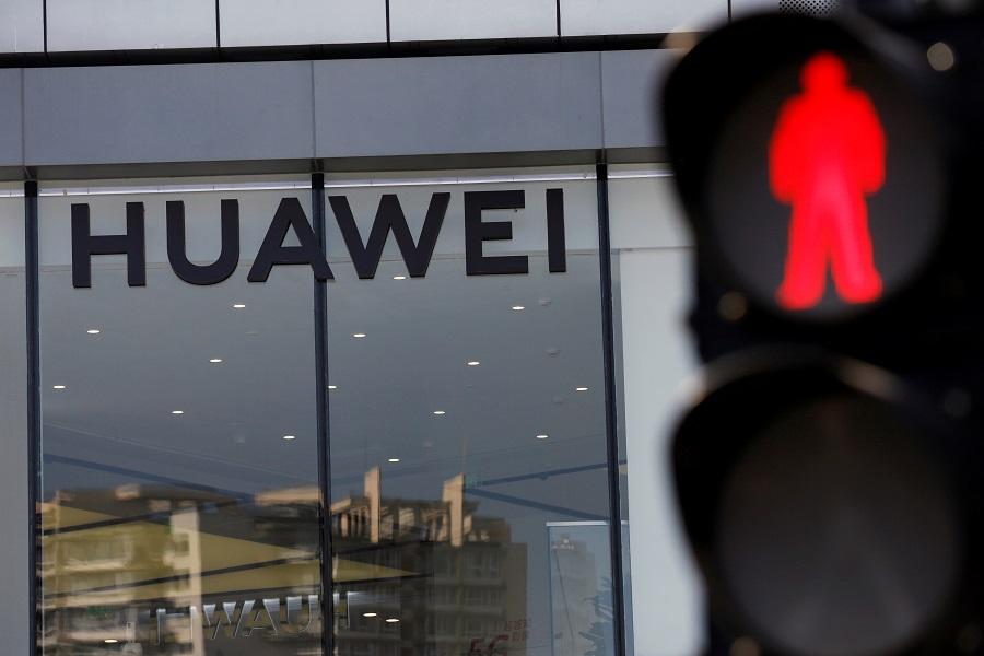A Huawei sign is seen on its store near a traffic light in Beijing, China, on 14 July 2020. (Tingshu Wang/File Photo/Reuters)