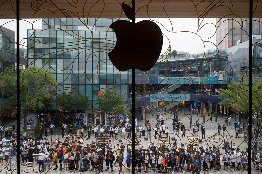 People line up outside the new Apple flagship store on its opening day following the Covid-19 outbreak, in Sanlitun, Beijing, China, on 17 July 2020. (Thomas Peter/Reuters)