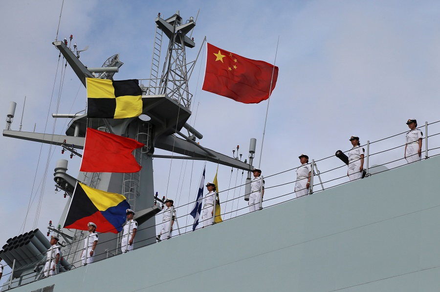 Soldiers of China's People's Liberation Army (PLA) stand on a ship sailing off to set up a base in Djibouti, from a military port in Zhanjiang, Guangdong province, China, 11 July 2017. (Stringer/File Photo/Reuters)