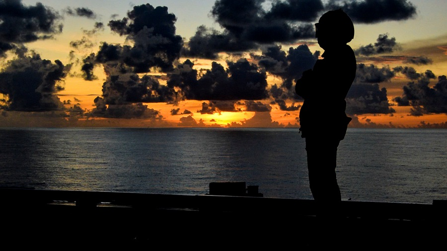 A US Navy sailor signals to an MH-60R Sea Hawk helicopter during flight operations aboard the aircraft carrier USS Ronald Reagan in the South China Sea, 17 July 2020. (US Navy/Mass Communication Specialist 2nd Class Codie L. Soule/Handout via Reuters)