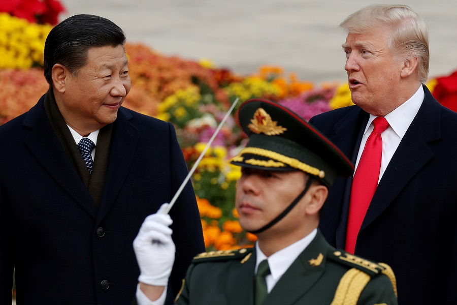 US President Donald Trump takes part in a welcoming ceremony with Chinese President Xi Jinping at the Great Hall of the People in Beijing, China, 9 November 2017. (Damir Sagolj/File Photo/Reuters)