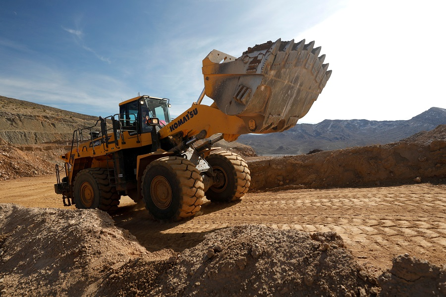A wheel loader takes ore to a crusher at the MP Materials rare earth mine in Mountain Pass, California, 30 January 2020. (Steve Marcus/File Photo/Reuters)