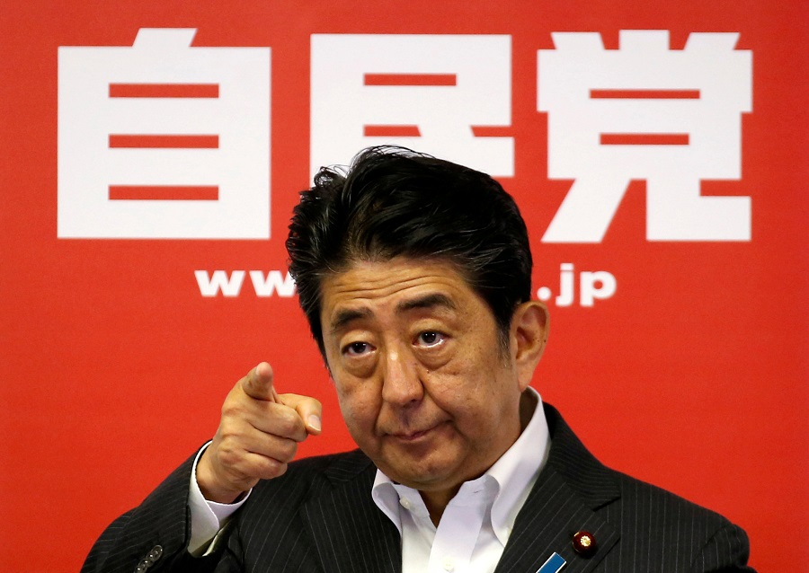 Japan Prime Minister and leader of the ruling Liberal Democratic Party (LDP) Shinzo Abe attends a news conference following a victory in the upper house elections by his ruling coalition, at the LDP headquarters in Tokyo, Japan, 11 July 2016. (Toru Hanai/File Photo/Reuters)