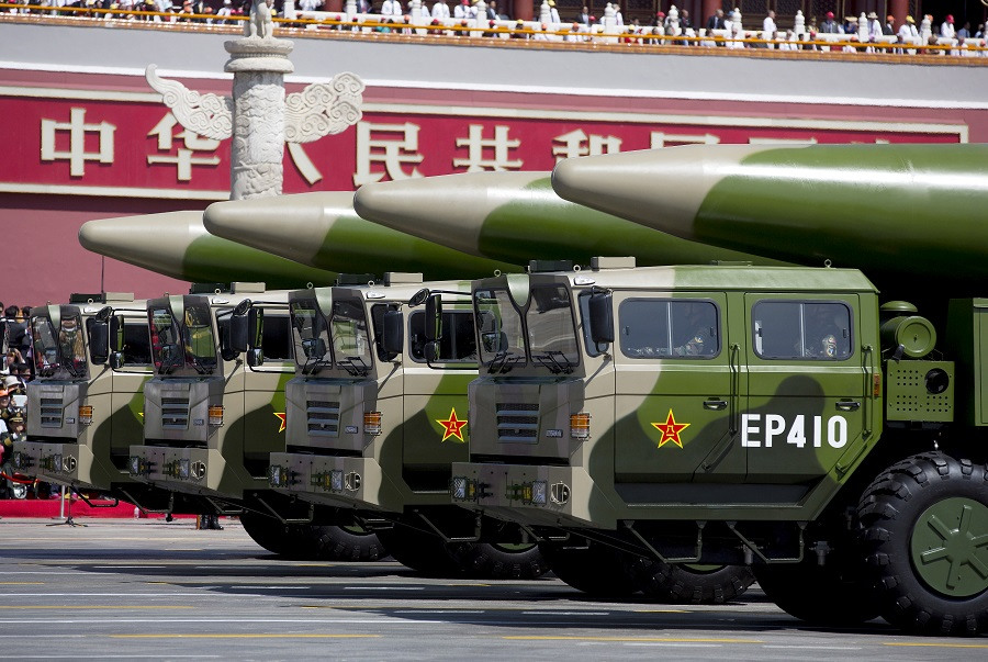 Military vehicles carrying DF-26 ballistic missiles travel past Tiananmen Gate during a military parade to commemorate the 70th anniversary of the end of World War II in Beijing, China, 3 September 2015. (Andy Wong/Pool via Reuters/File Photo)