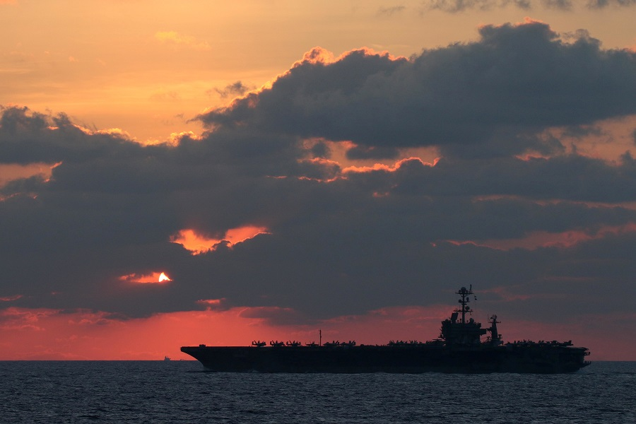 The US Navy aircraft carrier USS John C. Stennis transits the South China Sea at sunset, 25 February 2019. (US Navy/Mass Communication Specialist 1st Class Ryan D. McLearnon/Handout via Reuters)