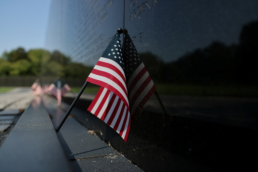 A small US flag is left at the Vietnam Veterans Memorial in Washington, US, 4 September 2020. (Jonathan Ernst/Reuters)