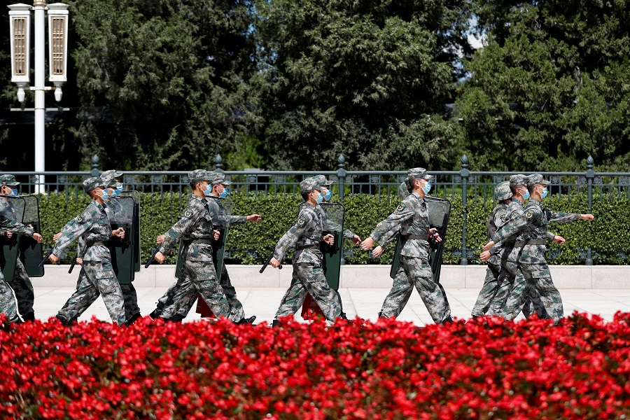 Soldiers of the People's Liberation Army (PLA) march outside the Great Hall of the People in Beijing, China, 8 September 2020. (Carlos Garcia Rawlins/Reuters)