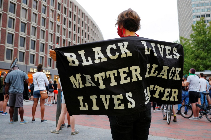 A demonstrator holds a Black Lives Matter banner during Action Against Police Brutality's march demanding a special prosecutor to reopen past cases of police brutality in Boston, Massachusetts, US, 9 September 2020. (Brian Snyder/Reuters)
