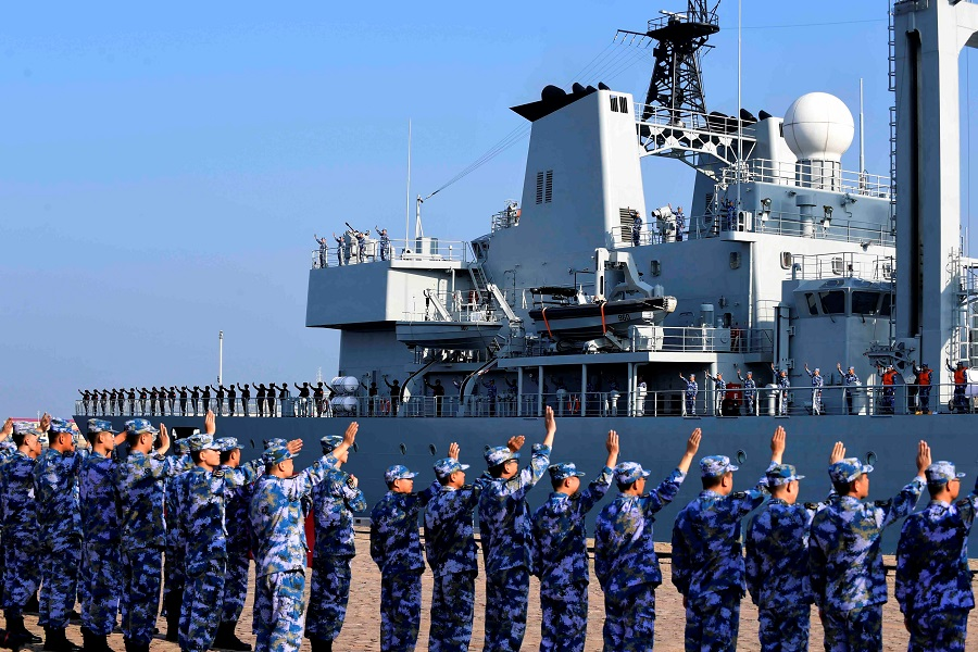 Soldiers of the Chinese People's Liberation Army (PLA) Navy take part in a ceremony as a replenishment ship sets sail to the Gulf of Aden and the waters off Somalia, from a naval port in Qingdao, Shandong province, China, 3 September 2020. (China Daily via Reuters)