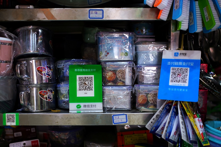 QR codes for WeChat Pay and Alipay are seen at a market in Beijing, China, 18 September 2020. (Tingshu Wang/Reuters)