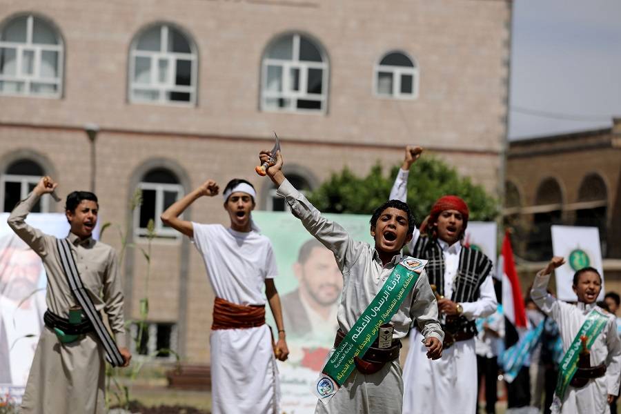 Students shout slogans during a ceremony to mark the 6th anniversary of the takeover of Yemen's capital Sana'a by the Houthi movement, in Sana'a, Yemen, 20 September 2020. (Khaled Abdullah/Reuters)