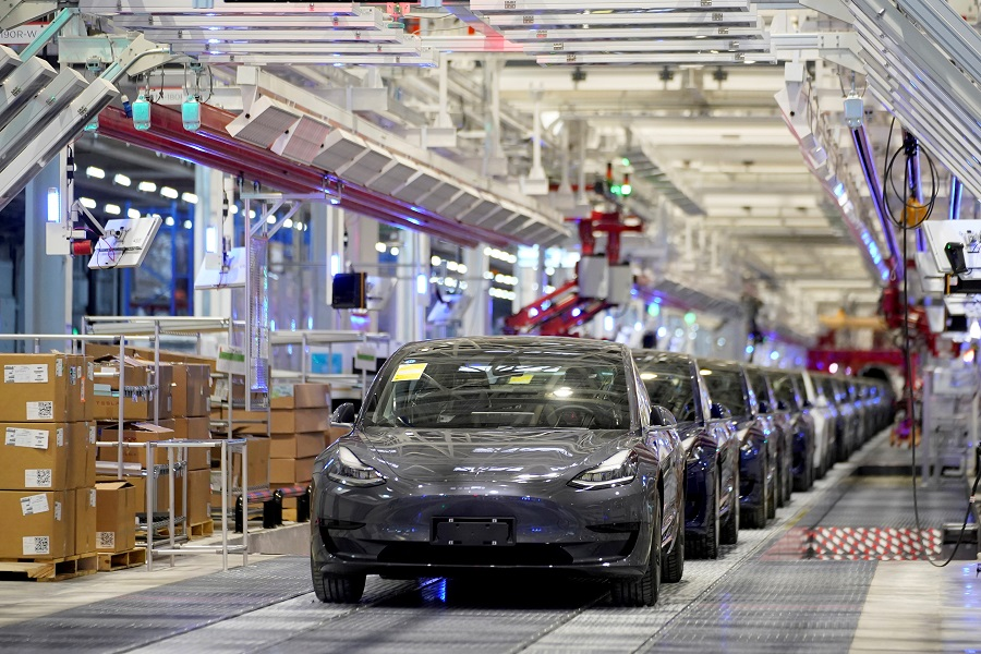 Tesla China-made Model 3 vehicles are seen during a delivery event at its factory in Shanghai, China, 7 January 2020. (Aly Song/File Photo/Reuters)