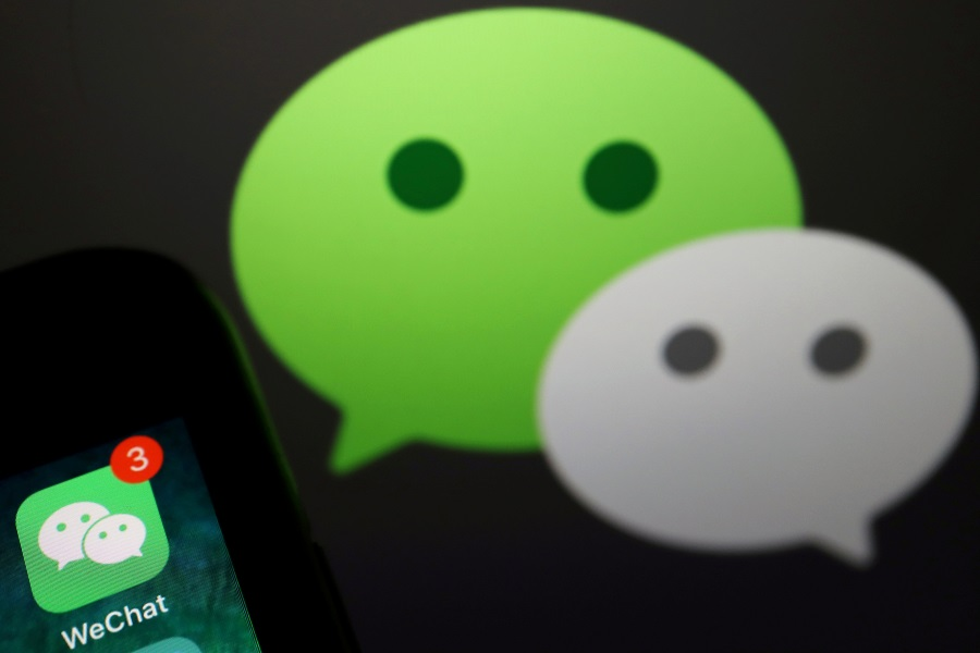 The messenger app WeChat is seen next to its logo in this illustration picture taken 7 August 2020. (Florence Lo/Illustration/File Photo/Reuters)