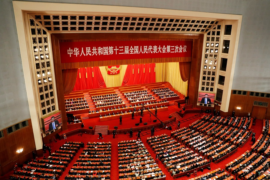 Chinese officials and delegates attend the closing session of the National People's Congress (NPC) at the Great Hall of the People in Beijing, China, 28 May 2020. (Carlos Garcia Rawlins/File Photo/Reuters)