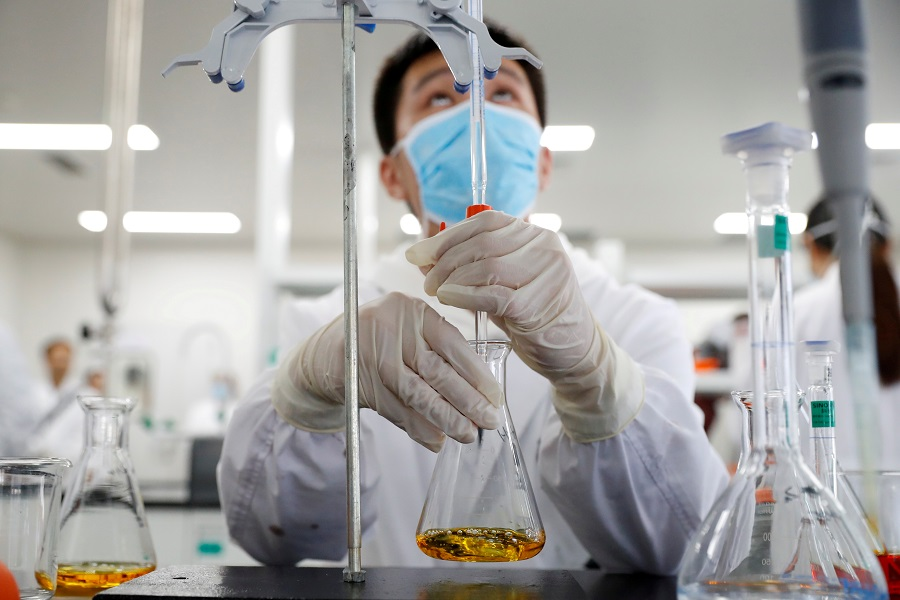 A man works in a laboratory of Chinese vaccine maker Sinovac Biotech, developing an experimental Covid-19 vaccine, Beijing, China, 24 September 2020. (Thomas Peter/File Photo/Reuters)