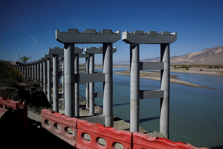 Pillars for a highway bridge are seen during construction in Samzhubze County, Tibet Autonomous Region, China, 17 October 2020. (Thomas Peter/Reuters)
