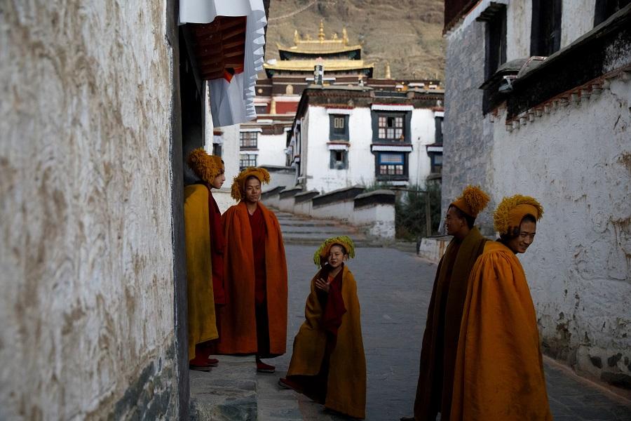 Monks leave morning prayers at Tashi Lhunpo Monastery in Shigatse, Tibet Autonomous Region, China, 18 October 2020. (Thomas Peter/Reuters)