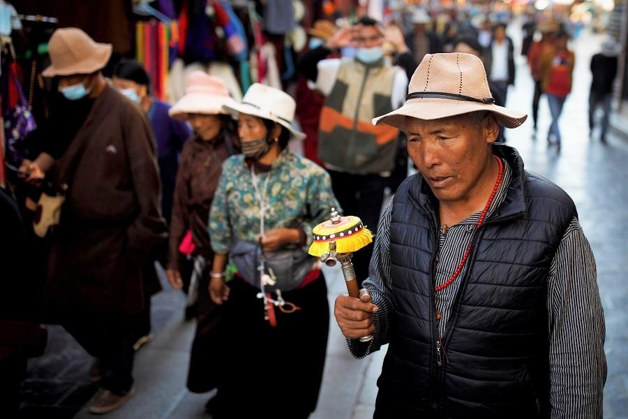 Tibetans perform a pilgrimage around the Jokhang Temple in Lhasa, Tibet Autonomous Region, China, 15 October 2020. (Thomas Peter/Reuters)
