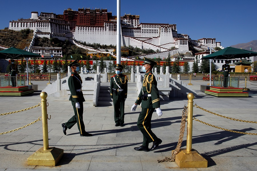 Paramilitary police officers perform a change of guard in front of Potala Palace in Lhasa, Tibet Autonomous Region, China, 15 October 2020. (Thomas Peter/Reuters)