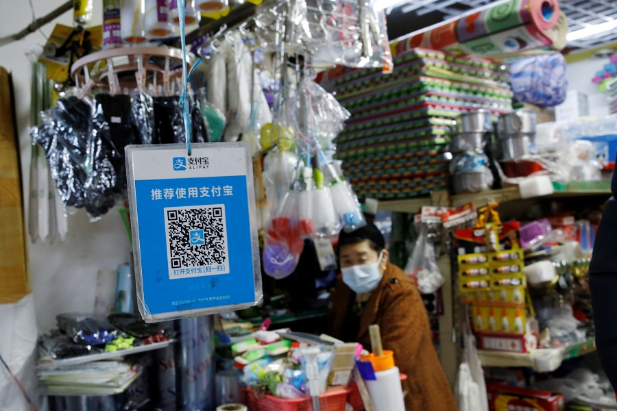 A QR code of digital payment device Alipay by Ant Group, an affiliate of Alibaba Group Holding, is seen at a grocery shop inside a market, in Beijing, China, 2 November 2020. (Tingshu Wang/Reuters)