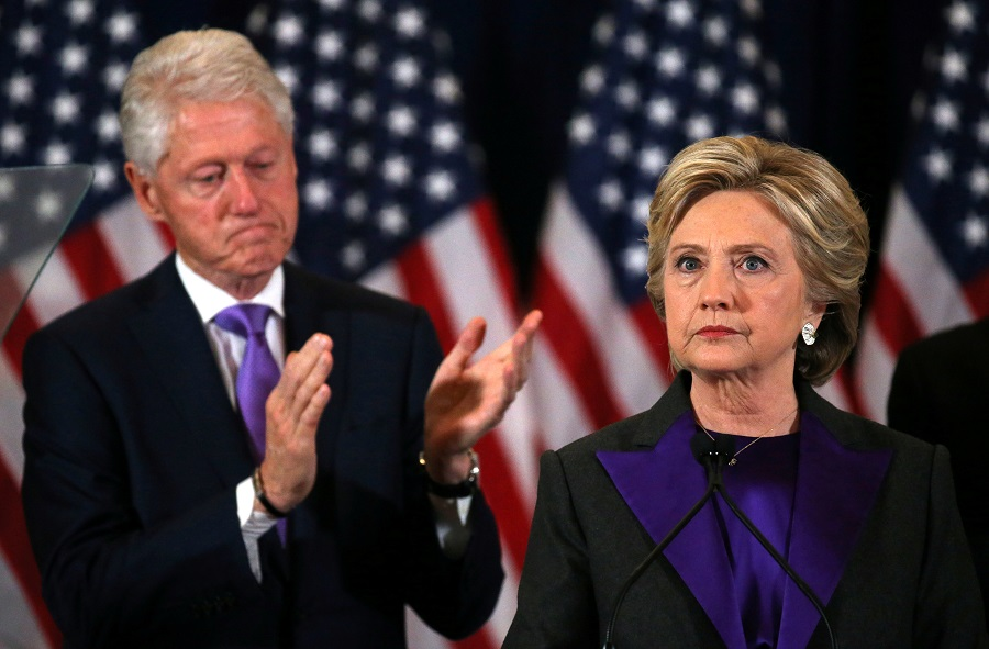 Hillary Clinton addresses her staff and supporters about the results of the US election as her husband, former US President Bill Clinton, applauds at a hotel in the Manhattan borough of New York, US, 9 November 2016. (Carlos Barria/File Photo/Reuters)