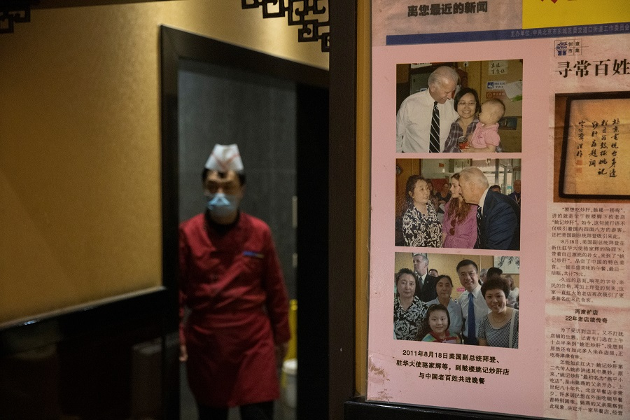 Pictures of the 2011 visit of then-US Vice President Joe Biden to the Yaoji Chaogan traditional Beijing cuisine restaurant are seen at its sister restaurant in Beijing, China, 9 November 2020. (Thomas Peter/Reuters)