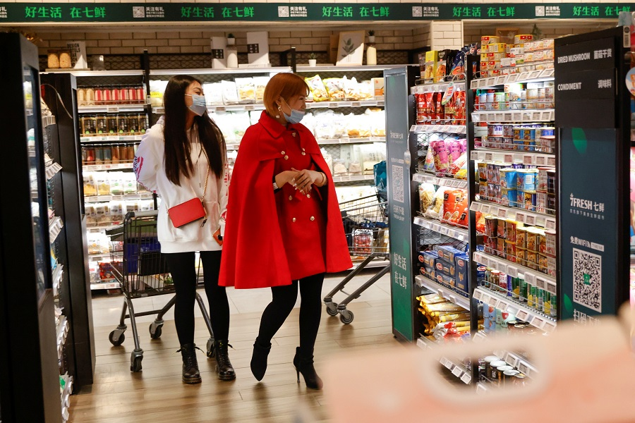 Women shop at JD's 7Fresh supermarket on China's Singles Day shopping festival in Beijing, China, 11 November 2020. (Thomas Peter/Reuters)