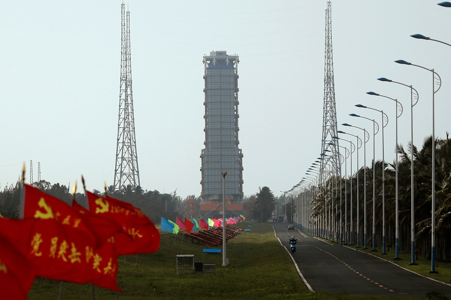 Flags with Chinese Communist Party's emblem flutter along a road leading to a launch tower with the Long March-5 Y5 rocket inside before its launch, at Wenchang Space Launch Center in Hainan Province, China, 23 November 2020. (Tingshu Wang/Reuters)