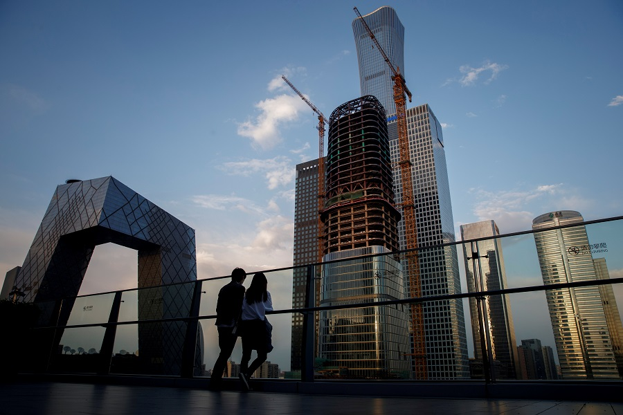 People look at the skyline of the central business district in Beijing, China, 16 April 2020. (Thomas Peter/File Photo/Reuters)