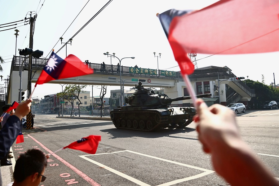 People wave Taiwan flags while soldiers driving M60 tanks pass on a street as part of a military drill in Taichung, Taiwan, 3 November 2020. (Ann Wang/File Photo/Reuters)