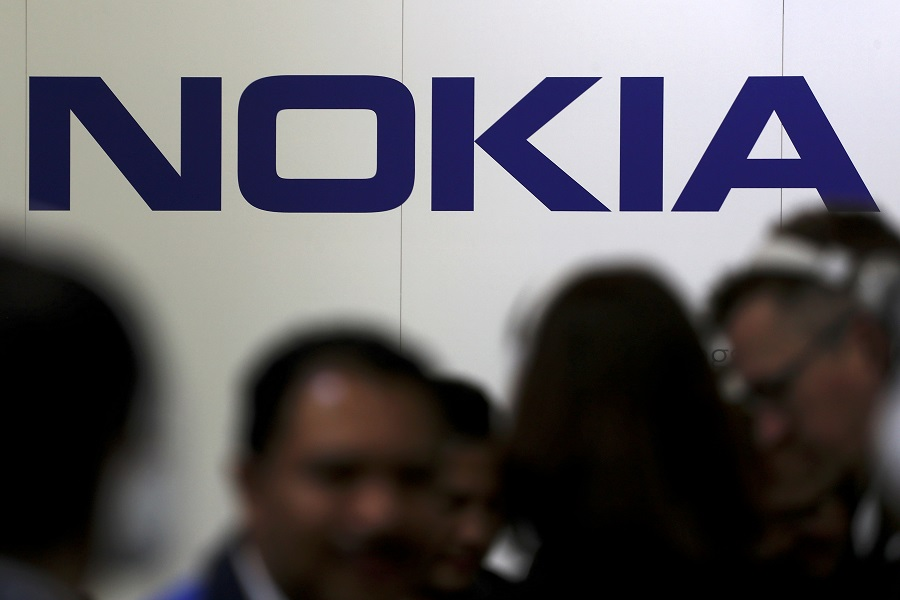 Visitors gather outside the Nokia booth at the Mobile World Congress in Barcelona, Spain, 26 February 2019. (Sergio Perez/File Photo/Reuters)