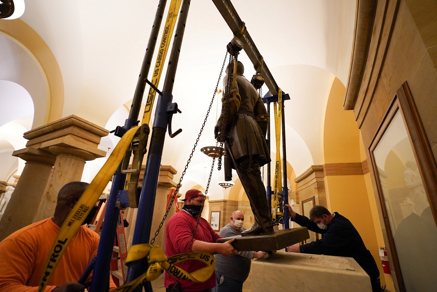 People work on the removal of the statue of Confederate General Robert E. Lee from the US Capitol crypt on Capitol Hill in Washington, US, 21 December 2020. (Jack Mayer, Office of Governor Northam/Handout via Reuters)