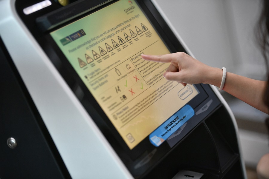 An automated kiosk fitted with proximity touch screens with infrared sensors to track finger movements is seen at the Singapore Changi Airport. (SPH)