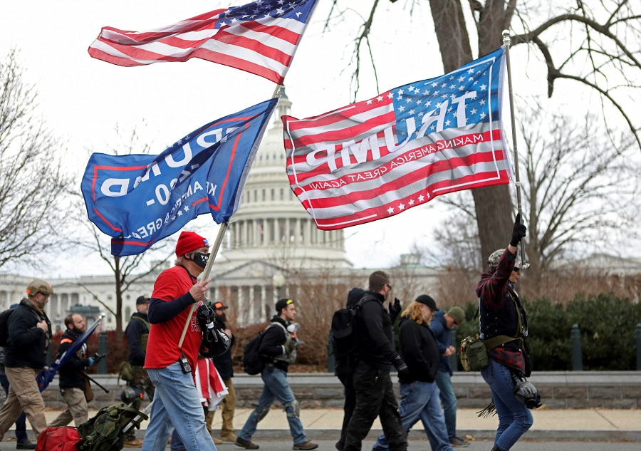Supporters of US President Donald Trump protest against the certification of the 2020 presidential election results by the Congress, in Washington, US, 6 January 2021. (Jim Urquhart/Reuters)