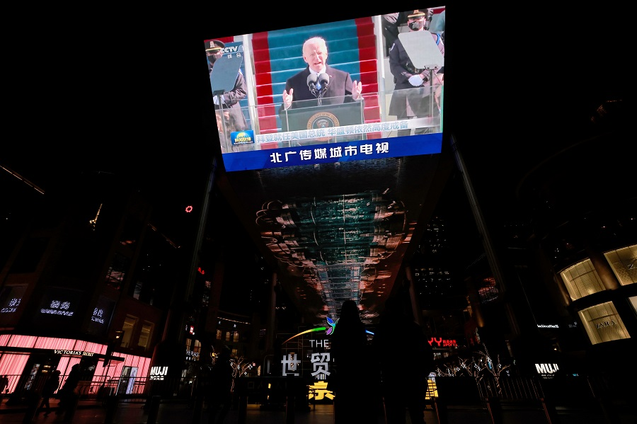 A screen shows a CCTV state media news cast of the inauguration of US President Joe Biden, at a shopping centre Beijing, China, 21 January 2021. (Thomas Peters/Reuters)