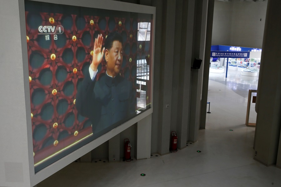 A screen showing Chinese President Xi Jinping is seen inside the Olympic Tower during an organised media tour to the 2022 Winter Olympic Games venues in Beijing, China, 22 January 2021. (Tingshu Wang/Reuters)