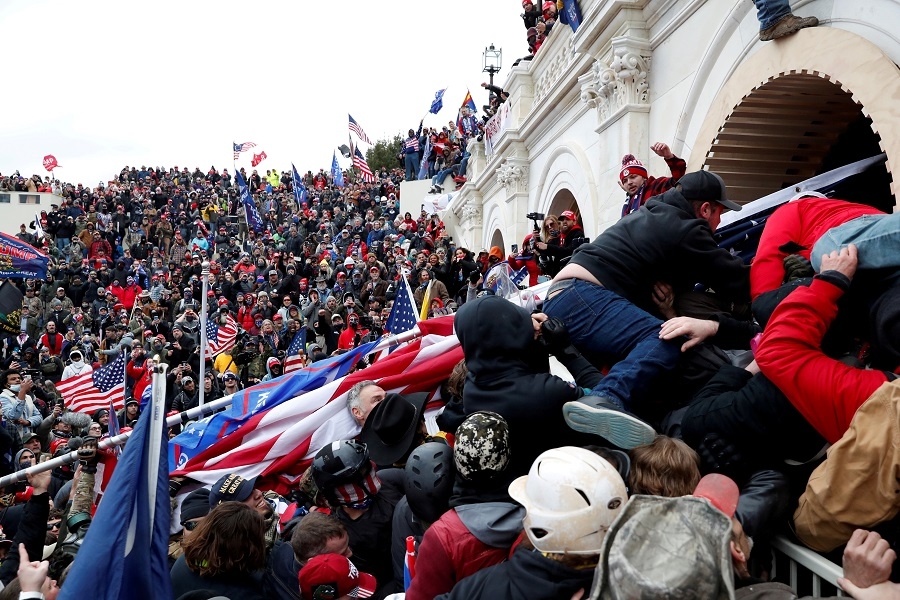 Pro-Trump protesters storm into the US Capitol during clashes with the police, during a rally to contest the certification of the 2020 US presidential election results by the US Congress, in Washington, US, 6 January 2021. (Shannon Stapleton/File Photo/Reuters)
