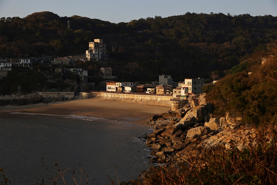 A village is seen during sunset hours on Nangan island, the main island of the Taiwan-controlled Matsu islands, 28 January 2021. (Ann Wang/Reuters)