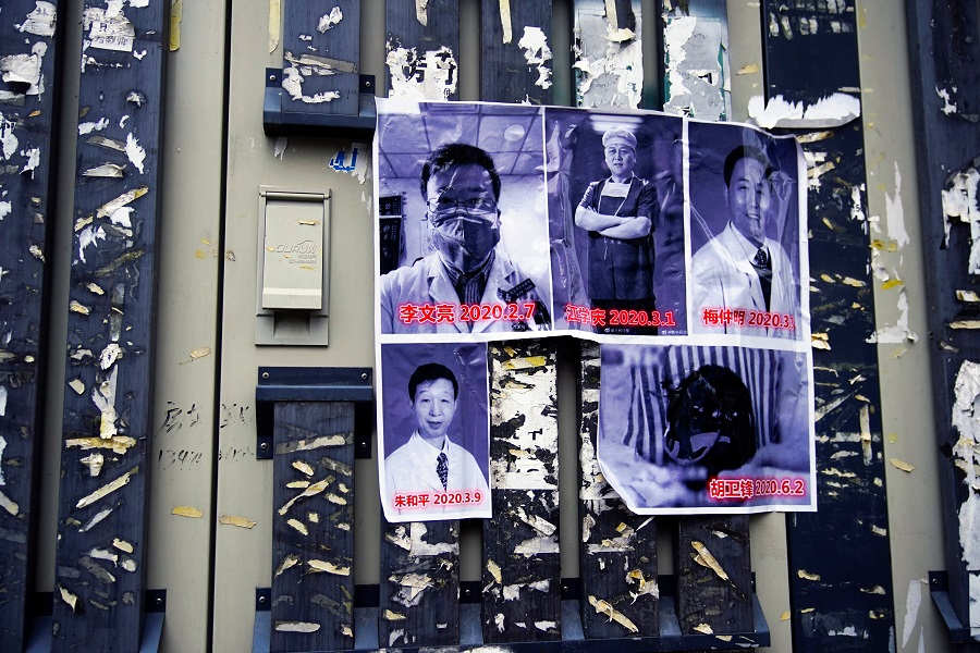 Posters in memory of late doctor Li Wenliang and other doctors are seen on a street near the Central Hospital of Wuhan, in Wuhan, Hubei province, China, 7 February 2021. (Aly Song/Reuters)