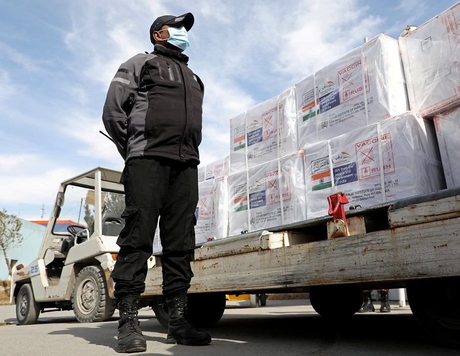 An Indian security personnel stands guard next to the boxes containing vials of Covishield, a Covid-19 vaccine donated by Indian government in Kabul, Afghanistan, 7 February 2021. (Omar Sobhani/File Photo/Reuters)